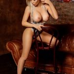 Extra Istanbul VIP escort playful maiden Bella is revealing her perfectly shaped breasts and unimaginably slender legs wearing high heels of beige color