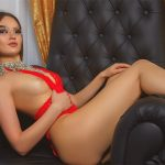 Eskortlar Istanbul girl Alina makes you salivate from looking at her as she is lying in the big soft chair of black color